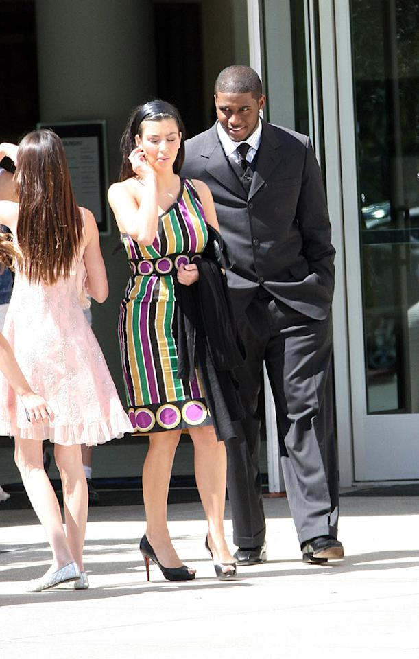 "Reality/sex tape star Kim Kardashian and her boyfriend, NFL running back Reggie Bush, are spotted leaving church on Easter Sunday. <a href=""http://www.infdaily.com"" target=""new"">INFDaily.com</a> - March 23, 2008"