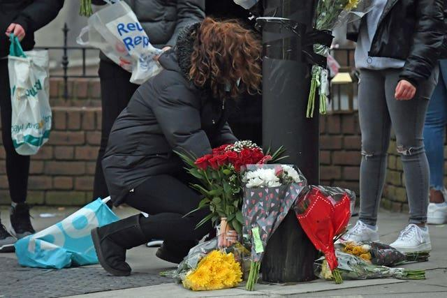 Flowers are laid at the site of the incident (Kirsty O'Connor/PA)