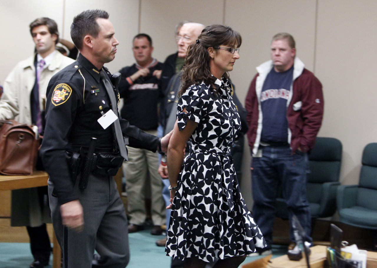 Stacy Schuler, a former health and physical education teacher at Mason High School, is led out of the Warren County Common Pleas Courtroom of Judge Robert Peeler Thursday Oct. 27, 2011 in Lebanon, Ohio. Schuler, a high school teacher was convicted Thursday of having sex with five students, some of them football players, after an Ohio judge rejected an insanity defense that argued the teens took advantage of her. (AP Photo/The Cincinnati Enquirer, Gary Landers) MANDATORY CREDIT; NO SALES