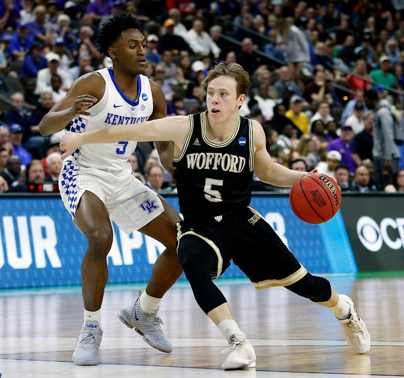 Wofford's Storm Murphy, right, makes a move to get past Kentucky's Immanuel Quickley during the first half of the second round of a men's college basketball game in the NCAA Tournament in Jacksonville, Fla., Saturday, March 23, 2019. (AP Photo/Stephen B. Morton)