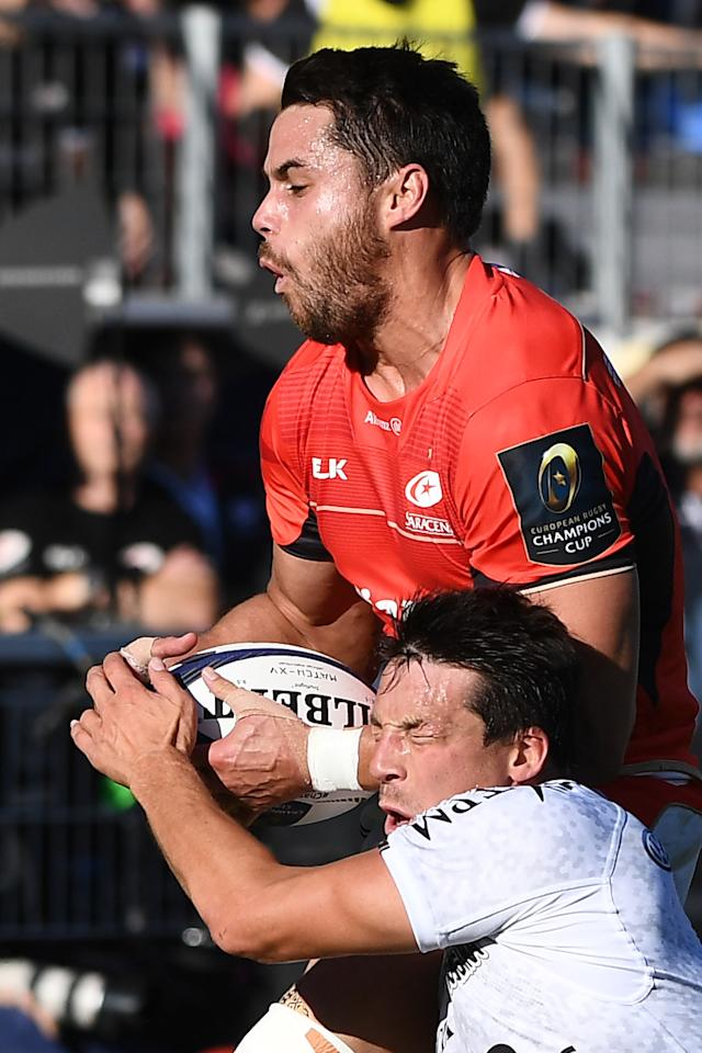 RC Toulon's French fly-half Francois Trinh-Duc (Down) fights for the ball with Saracens' Sean Maitlanup (L) during the European Champions Cup rugby union match between Toulon and Saracens at the Mayol stadium in Toulon on October 15, 2016. (AFP Photo/BORIS HORVAT)