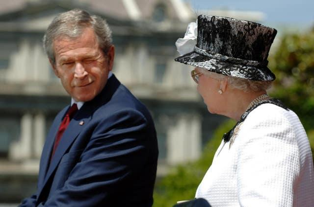 George Bush winks at the Queen
