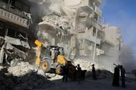 A front loader removes debris in a damaged site after airstrikes on the rebel held Tariq al-Bab neighbourhood of Aleppo, Syria September 24, 2016. REUTERS/Abdalrhman Ismail