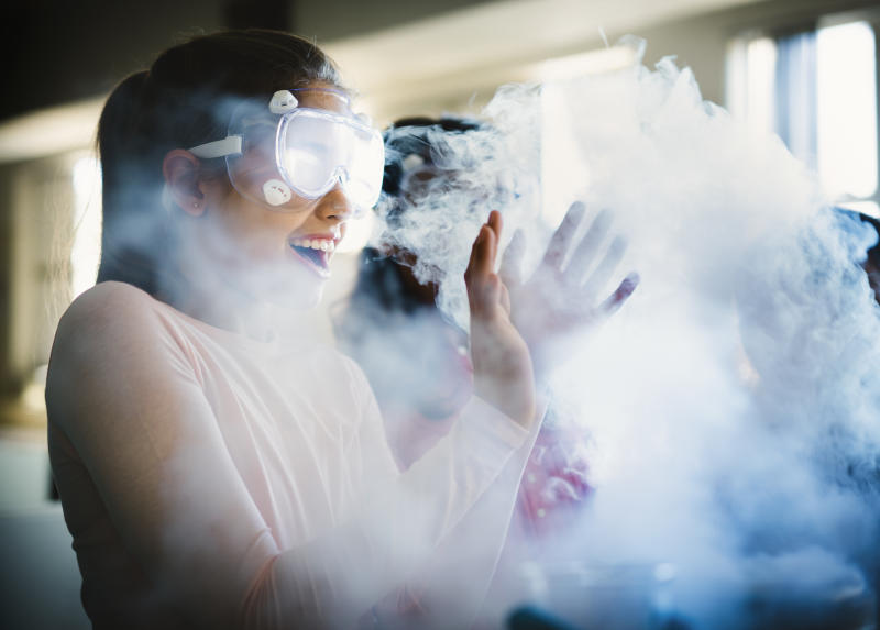 Girl surprised by a smokey science experiment.