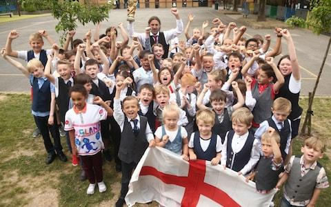 Pupils and staff at Minster Church of England Primary School in Ramsgate wear waistcoats in honour of Gareth Southgate - Credit: PA