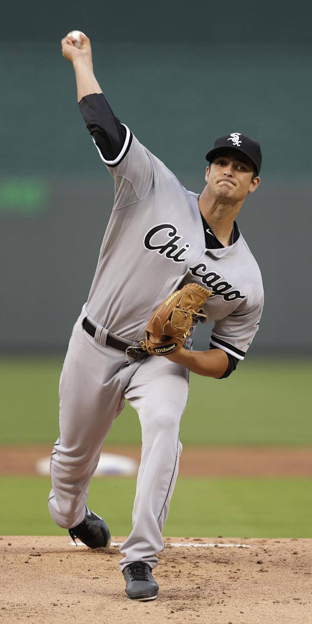 Chicago White Sox starting pitcher Andre Rienzo throws during the first inning of a baseball game against the Kansas City Royals, Wednesday, Aug. 21, 2013, in Kansas City, Mo. (AP Photo/Charlie Riedel)