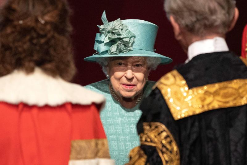 Britain's Queen Elizabeth talks with officials following her speech during at the State Opening of Parliament at the Palace of Westminster in London, Britain December 19, 2019. Richard Pohle/Pool via REUTERS