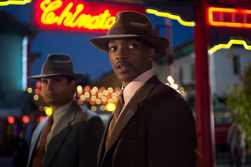 "This film image released by Warner Bros. Pictures shows Michael Pena, left, as Officer Navidad Ramirez and Anthony Mackie, as Officer Coleman Harris, in ""Gangster Squad."" (AP Photo/Warner Bros. Pictures, Jamie Trueblood)"