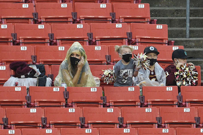 Alex Smith's wife, Elizabeth Smith sits next to the couple's children during Sunday's game.