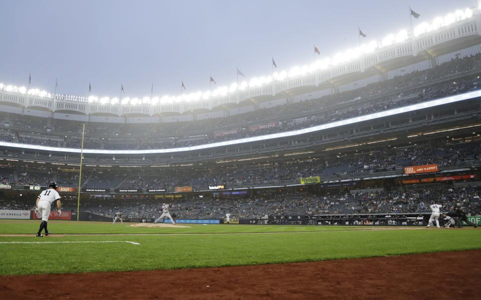 Minnesota Twins' Kyle Gibson, center, delivers a pitch to New York Yankees' Luke Voit, right, during the first inning of a baseball game Friday, May 3, 2019, in New York. (AP Photo/Frank Franklin II)