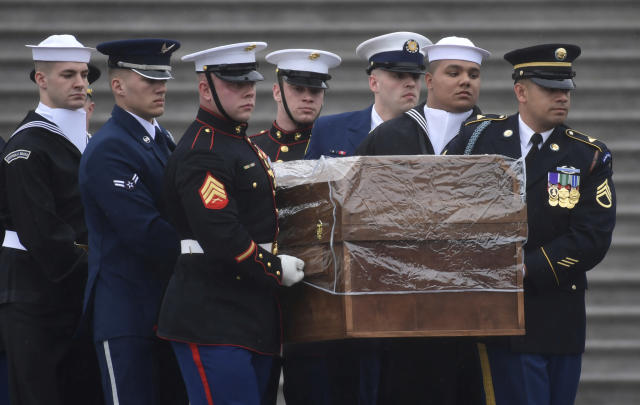 <p>The casket of Rev. Billy Graham is carried out of the U.S. Capitol in Washington, Thursday, March 1, 2018. (Photo: Susan Walsh/AP) </p>