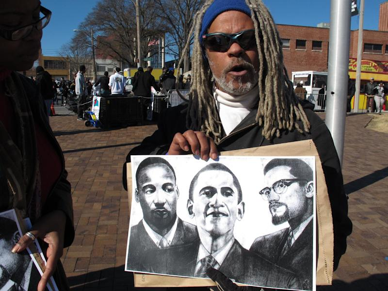 Walter Andrade holds up a picture he drew of Martin Luther King Jr., President Barack Obama and Malcolm X on Monday, Jan. 21, 2013 in Memphis, Tenn. Andrade was visiting the National Civil Rights Museum, which is hosting several events to celebrate Martin Luther King Jr. Day. The museum is built on the site of the old Lorraine Motel, where King was assassinated on April 4, 1968. (AP Photo/Adrian Sainz)
