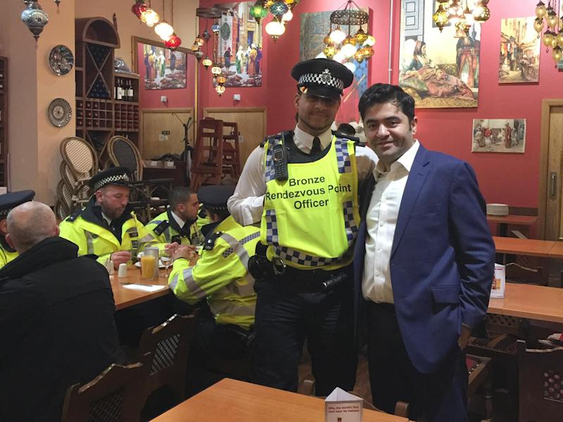 Ibrahim Dogus with police officers in Troia restaurant