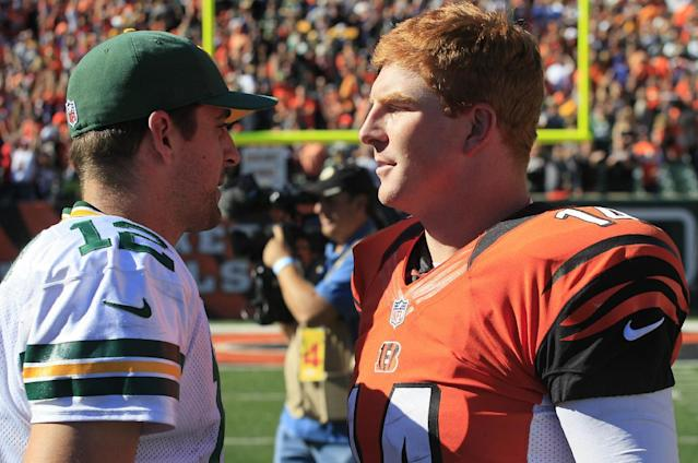 Cincinnati Bengals quarterback Andy Dalton, right, meets with Green Bay Packers quarterback Aaron Rodgers after the Bengals defeated the Packers 34-30 in an NFL football game, Sunday, Sept. 22, 2013, in Cincinnati. (AP Photo/Tom Uhlman)