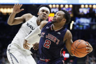 St. John's Shamorie Ponds (2) drives against Xavier's Paul Scruggs (1) in the second half of an NCAA college basketball game, Saturday, March 9, 2019, in Cincinnati. (AP Photo/John Minchillo)