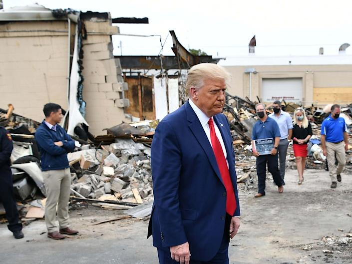 Donald Trump tours an area affected by civil unrest in Kenosha, Wisconsin, on 1 September 2020: Mandel Ngan/AFP/Getty