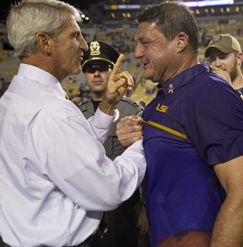 LSU interim coach Ed Orgeron, right, is congratulated by athletic director Joe Alleva after an NCAA college football game against Missouri in Baton Rouge, La., Saturday, Oct. 1, 2016. LSU won 42-7. (AP Photo/Max Becherer)