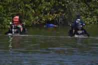Authorities look at the body of 27-year-old Keishla Rodriguez in the San Jose lagoon after she was reported missing in San Juan, Puerto Rico, Saturday, May 1, 2021. A federal judge on Monday ordered Puerto Rican boxer Félix Verdejo held without bail after he was charged in the death of Rodriguez, his pregnant lover. (AP Photo/Carlos Giusti)