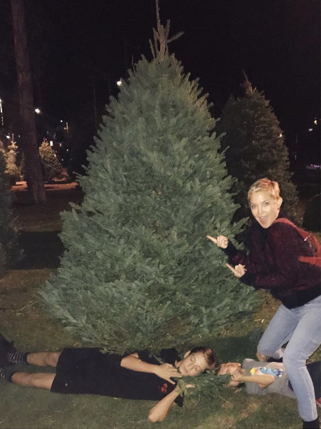 "<p>Boys will be boys! ""My kids interpretation of a 'nice pic' in front of the tree,"" the actress shared. Her two sons, Ryder and Bing, obviously thought pretending to nap under the family's new purchase was the way to go for a good holiday snap. (Photo: <a href=""https://www.instagram.com/p/Bc6M_fPgwUh/?taken-by=katehudson"" rel=""nofollow noopener"" target=""_blank"" data-ylk=""slk:Kate Hudson via Instagram"" class=""link rapid-noclick-resp"">Kate Hudson via Instagram</a>) </p>"