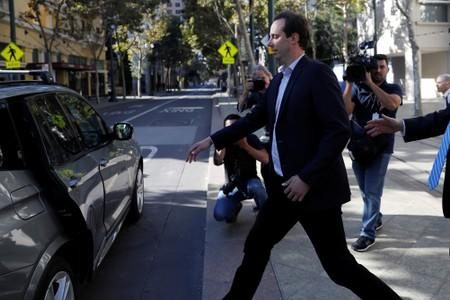 Former Google and Uber engineer Anthony Levandowski walks to an awaiting vehicle after his arraignment hearing at the federal court in San Jose