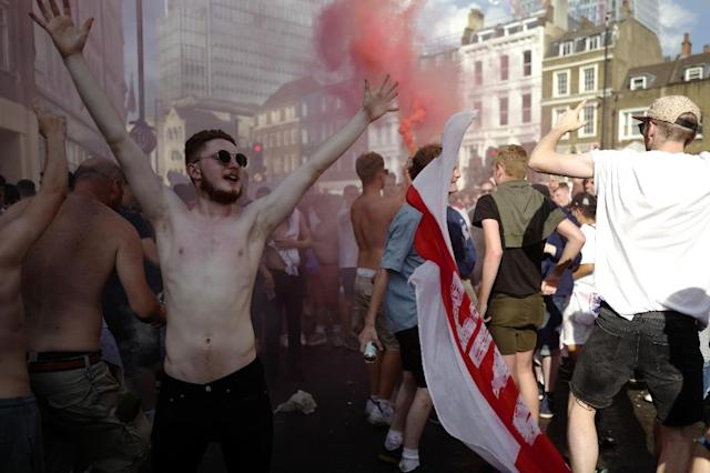 People celebrate in London after England beat Sweden in the World Cup quarter-finals (AFP Photo/Tolga AKMEN)
