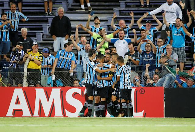 Soccer Football - Uruguay's Defensor Sporting v Brazil's Gremio - Copa Libertadores - Luis Franzini stadium, Montevideo, Uruguay - February 27, 2018. Maicon (obscured) of Gremio is congratulated by team mates after scoring. REUTERS/Andres Stapff