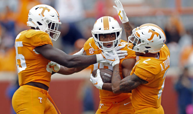 Tennessee defensive back Nigel Warrior (18) celebrates with defensive back Alontae Taylor (2) and linebacker Daniel Bituli (35) after making an interception in the second half of an NCAA college football game against Mississippi State, Saturday, Oct. 12, 2019, in Knoxville, Tenn. (AP Photo/Wade Payne)