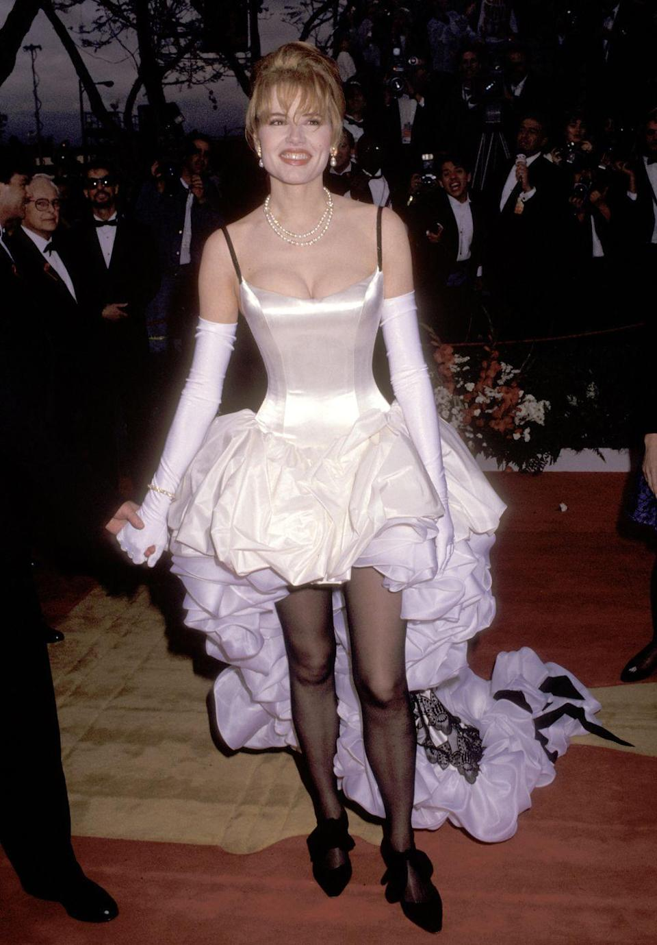 <p>The actress wore an extremely ruffled gown with a high-low hemline complete with sheer tights, opera-length gloves, and pearls to the Academy Awards. </p>