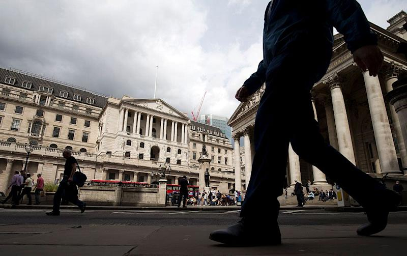 Bank of England holds interest rates and slashes growth forecast