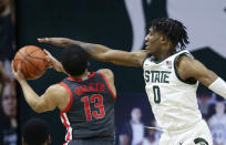 Michigan State forward Aaron Henry (0) defends against a shot by Ohio State guard CJ Walker (13) during the second half of an NCAA college basketball game Thursday, Feb. 25, 2021, in East Lansing, Mich. (AP Photo/Duane Burleson)