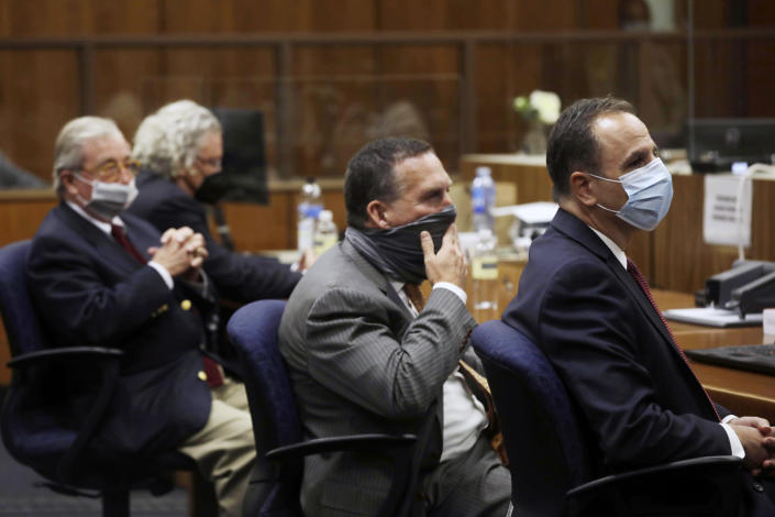 Attorney's for Robert Durst, David Chesnoff, left, and Dick Deguerin, with black mask, sit with prosecuting attorney's, Deputy District Attorney John Lewin and Habib A. Balian, right, listen as Los Angeles Superior Court Judge Mark E. Windham reads the verdict Friday, Sept. 17, 2021 in Inglewood, Calif. A Los Angeles jury convicted Robert Durst on Friday of murdering his best friend 20 years ago, a case that took on new life after the New York real estate heir participated in a documentary that connected him to the slaying that was linked to his wife's 1982 disappearance. (Genaro Molina/Los Angeles Times via AP, Pool)