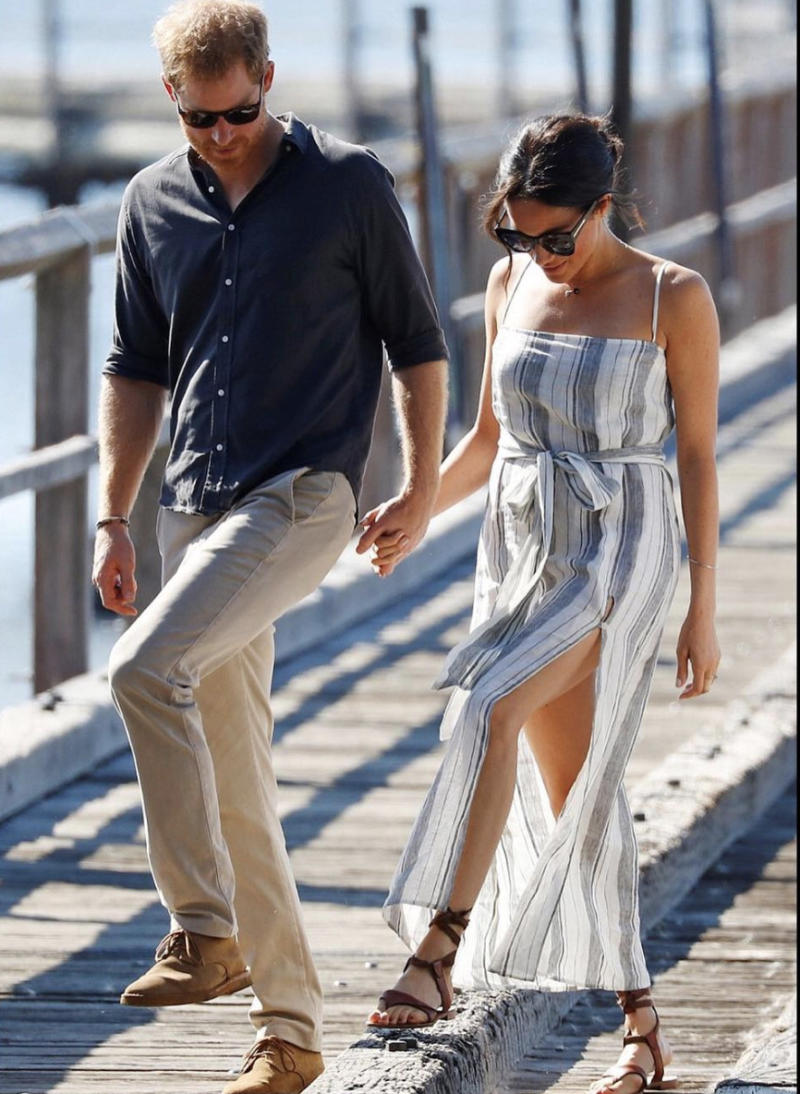 2e1b37379 Meghan Markle shamed for wearing dress with thigh-high slit while on tour  with Prince Harry