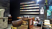 <p>A wide range of nail colours sets the backdrop of the nail salon. </p>