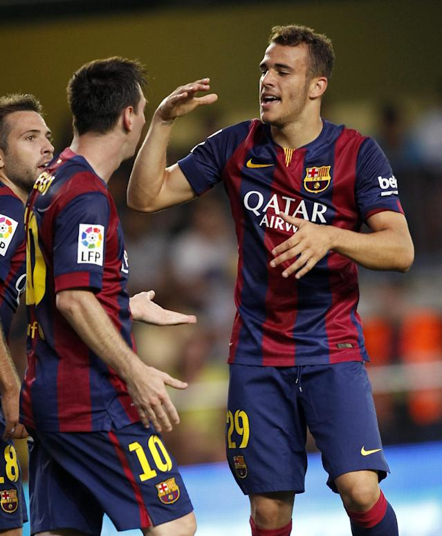 Barcelona's Sandro, right, is congratulated by teammate Lionel Messi, from Argentina, left, after scoring a goal against Villarreal during a Spanish La Liga soccer match at the Madrigal stadium in Villarreal, Spain, on Sunday, Aug 31, 2014.(AP Photo/Alberto Saiz)