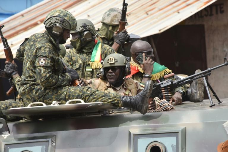 Guinean troops celebrate after President Alpha Conde is overthrown (AFP/CELLOU BINANI)