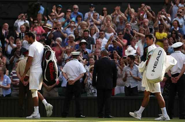 LONDON, ENGLAND - JULY 05: Novak Djokovic of Serbia and Juan Martin Del Potro of Argentina leave Centre Court after their Gentlemen's Singles semi-final match against Juan Martin Del Potro of Argentina on day eleven of the Wimbledon Lawn Tennis Championships at the All England Lawn Tennis and Croquet Club on July 5, 2013 in London, England. (Photo by Clive Brunskill/Getty Images)