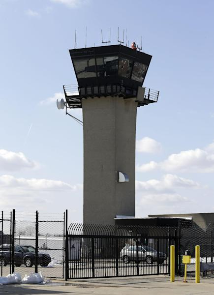 The control tower at Coleman A. Young International Airport is shown in Detroit, Friday, March 8, 2013. Six air traffic control towers in Michigan are among 238 that could close nationwide, and two other airports could eliminate overnight shifts in early April 2013 as the Federal Aviation Administration prepares to shut off funding for those services. The shutdowns are the result of the FAA's move to reduce spending by $600 million under automatic federal budget cuts known as sequestration. The FAA cuts affect mostly small- and medium-sized airports, though officials predict flights to major cities could have delays. Michigan airports on the list are Ann Arbor, W.K. Kellogg in Battle Creek, Coleman A. Young in Detroit, Jackson County-Reynolds Field in Jackson, Muskegon County in Muskegon and Sawyer International in Marquette County's Sands Township.(AP Photo/Paul Sancya)