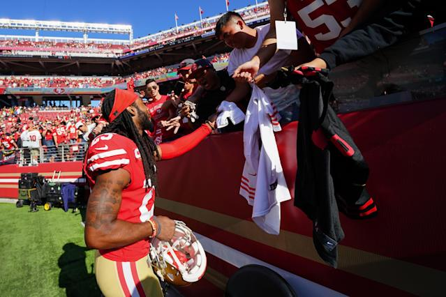 """The Niners' <a class=""""link rapid-noclick-resp"""" href=""""/nfl/players/24941/"""" data-ylk=""""slk:Richard Sherman"""">Richard Sherman</a> signs autographs for fans after last season's win in September against the Steelers at Levi's Stadium. It's unclear if games will be played in the 2020 season, let alone ones with fans there. (Photo by Daniel Shirey/Getty Images)"""
