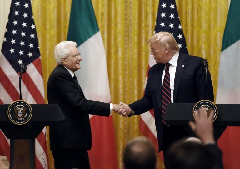 US President Donald Trump and Italian President Sergio Mattarella shake hands as they hold a joint press conference at the White House in Washington, DC, on October 16, 2019