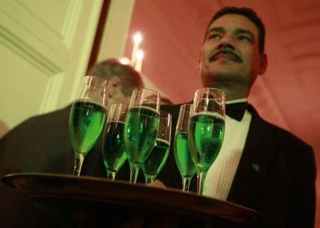 A waiter serves green champagne during a St Patrick's Day reception at the White House