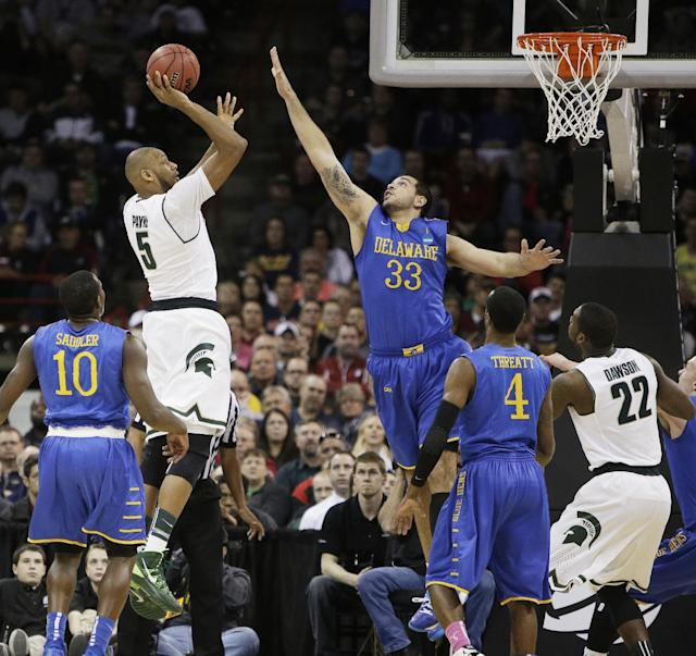 Michigan State's Adreian Payne (5) shoots over Delaware's Carl Baptiste (33) in the second half during the second round of the NCAA college basketball tournament in Spokane, Wash., Thursday, March 20, 2014. (AP Photo/Young Kwak)