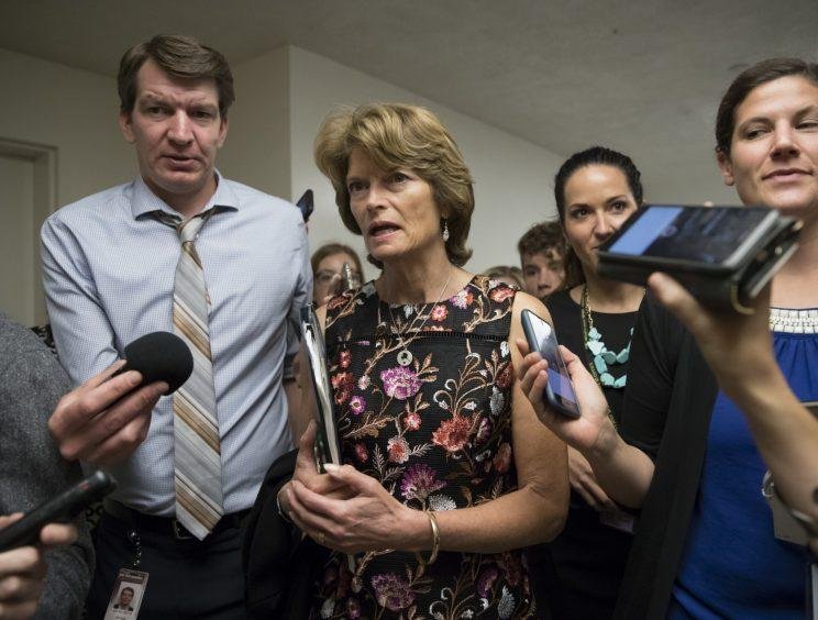 Sen. Lisa Murkowski, R-Alaska, and other lawmakers, head to the Senate on Capitol Hill in Washington, Thursday, July 13, 2017, for a meeting on the revised Republican health care bill which has been under attack from within the party, including by Murkowski. (Photo: J. Scott Applewhite/AP)