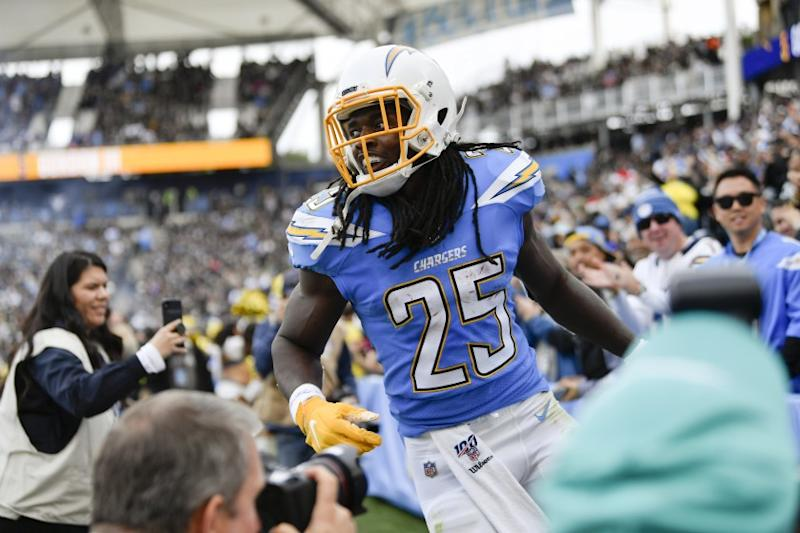 Los Angeles Chargers running back Melvin Gordon celebrates after scoring during the first half of an NFL football game against the Oakland Raiders Sunday, Dec. 22, 2019, in Carson, Calif. (AP Photo/Kelvin Kuo)