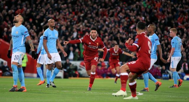 Liverpool's Alex Oxlade-Chamberlain celebrates scoring against Manchester City in a Champions League quarter-final