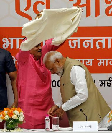 India's Transport Minister Nitin Gadkari presents a shawl to Prime Minister Narendra Modi during a thanksgiving ceremony by Bharatiya Janata Party (BJP) leaders to its allies at the party headquarters in New Delhi, India, May 21, 2019. REUTERS/Anushree Fadnavis