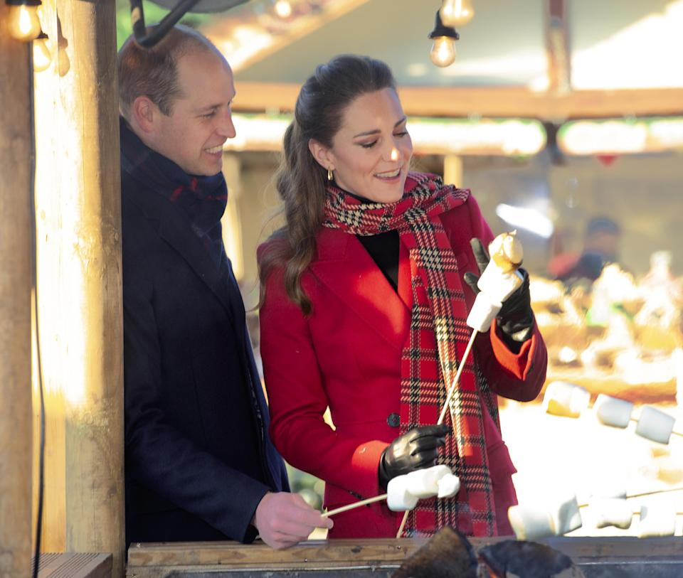 The Duke and Duchess of Cambridge toast marshmallows during a visit to Cardiff Castle in December during their three-day royal train trip to thank keyworkers around the country (Jonathan Buckmaster/Daily Express/PA)