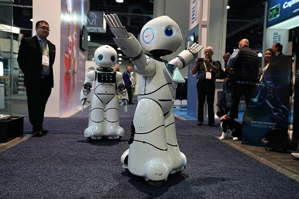 The U-Partner U05 humanoid service robots by Canbot, featured with free speech interaction, microsecond-level face recognition, autonomous obstacle avoidance walking, bionic action control and smart home hub, greet attendees during CES 2018, which runs through Jan. 12. (Photo by Alex Wong/Getty Images)
