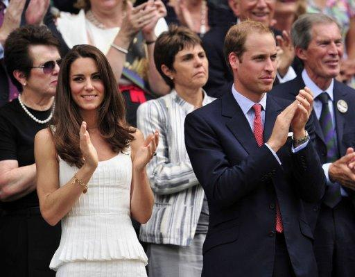 Britain's Prince William (R) and his wife Catherine the Duchess of Cambridge (L) applaud after watching Britain's Andy Murray beat France's Richard Gasquet at the 2011 Wimbledon Tennis Championships at the All England Tennis Club in London