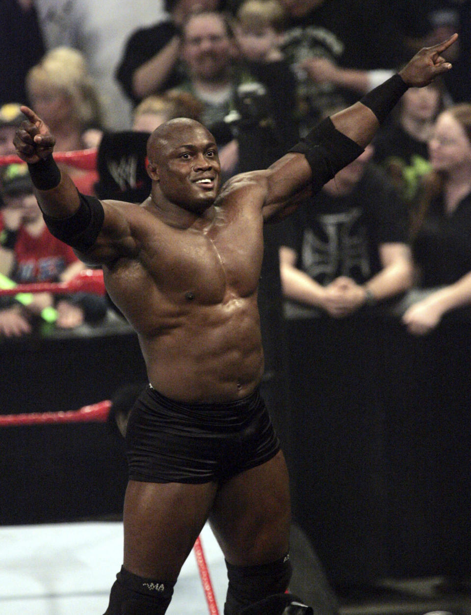 FILE - WWE wrestler Bobby Lashley celebrates after defeating Chris Masters during a match in Indianapolis, in this Monday, March 19, 2007, file photo. Fifty-four 54-year-old Bill Goldberg returns for his second match of the year when he challenges Lashley for the WWE title Saturday night, Aug. 21, 2021, at SummerSlam at Allegiant Stadium. (AP Photo/Tom Strattman, File)