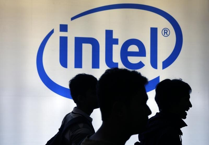 Indonesian youth walk past an Intel sign during Digital Imaging expo in Jakarta